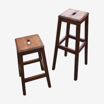 Two wooden artist stools in the early 20th century