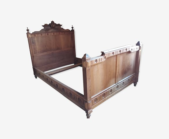 Old bed with medallion
