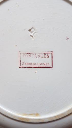 Plat rond en faïence de Sarreguemine