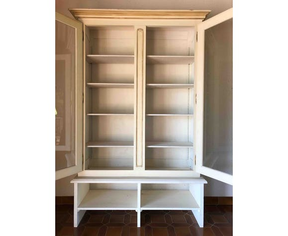 Wooden library painted in white