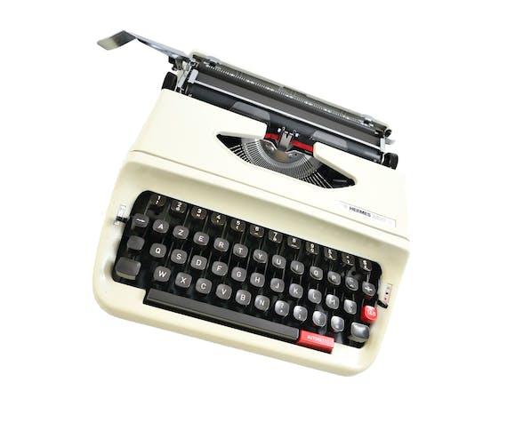 Machine à écrire Hermes baby S - révisée avec ruban neuf