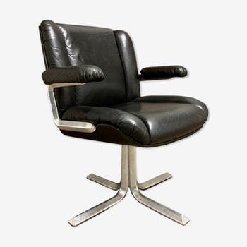 1960 design black leather and aluminum armchair.