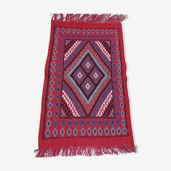Red descent Berber carpet of bed 62x98cm