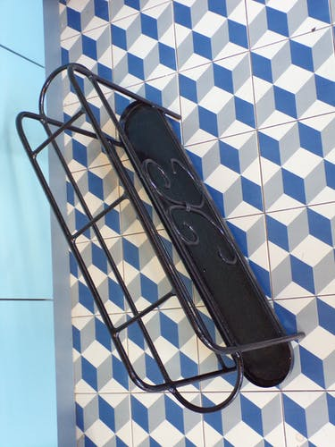 Old cane door and 1950 wrought iron umbrella