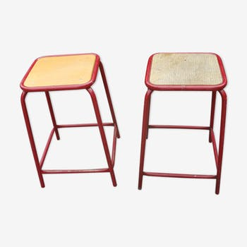 Pair of old red industrial stools