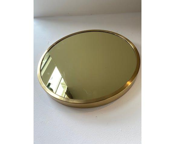 Miroir rond en métal d'or