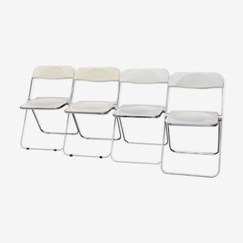 Series of 4 white Plia Castelli chairs