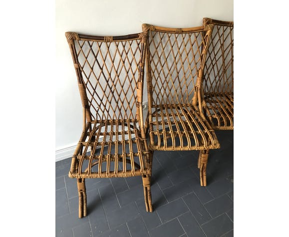 Suite of 4 chairs in rattan by Louis Sognot