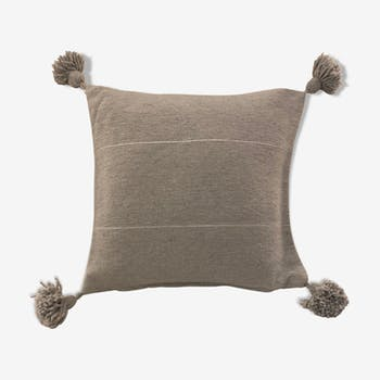 Grey cushion cover with pom poms