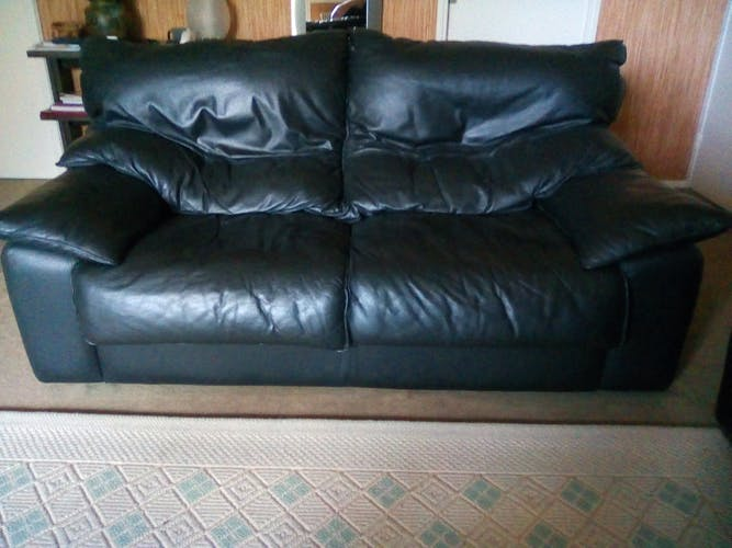 2-seater sofa set and black leather armchair