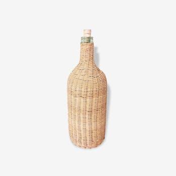 Bottle in glass and wicker
