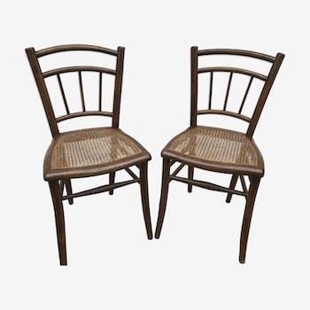 Paire de chaises bistrot anciennes en bois et cannage années 70