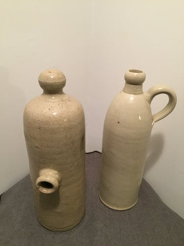 Old enamelled sandstone bottles