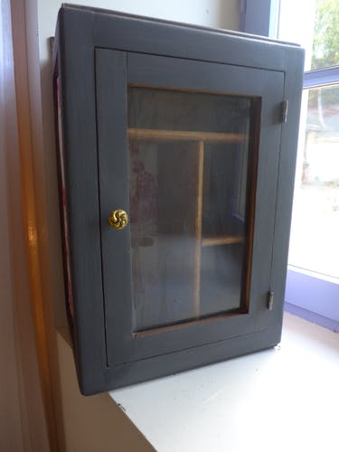Black patinated window cabinet