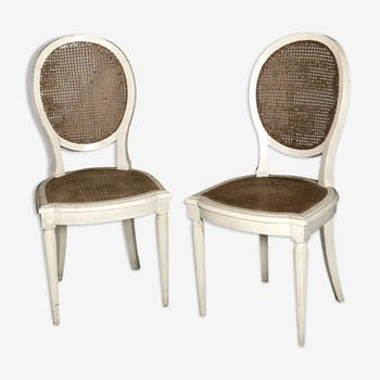Set of 2 Louis XVI style patinated beige and cannate chairs